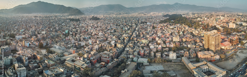 Fototapety, obrazy: Panoramic view from the drone to the capital of Nepal, Kathmandu. Sunset cityscape in Thamel district, the main tourist and historical district of Kathmandu