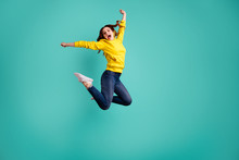 Full Length Body Size Photo Of Crazy Cheerful Charming Sweet Pretty Nice Cute Millennial Girl Wearing Jeans Denim Jumping Up After Knowing New Information Reacting Isolated Vivid Teal Color Background