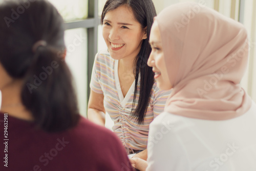 Obraz A group of women talked and presented ideas during the meeting. - fototapety do salonu