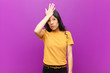 canvas print picture - young pretty latin woman raising palm to forehead thinking oops, after making a stupid mistake or remembering, feeling dumb against purple wall