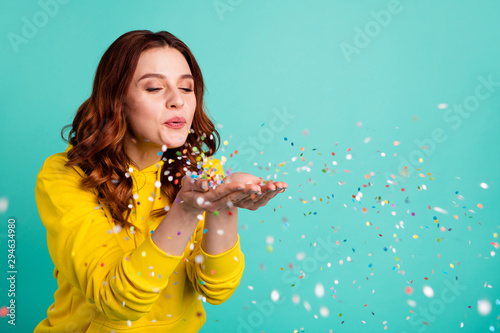Obraz Photo of curly wavy trendy white cheerful charming sweet pretty youngster blowing confetti away from his hands palms enjoying pocess isolated over turquoise vibrant color background - fototapety do salonu