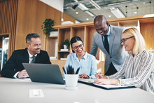 Diverse Group Of Businesspeople Laughing Together During An Offi