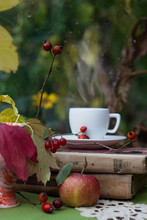 Books, Cup, And Apple On The Table. Autumn Still Life.
