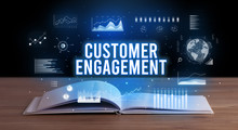 CUSTOMER ENGAGEMENT Inscription Coming Out From An Open Book, Creative Business Concept