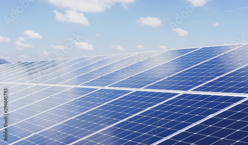 eco technology solar panel with sun and blue sky background Canvas Print