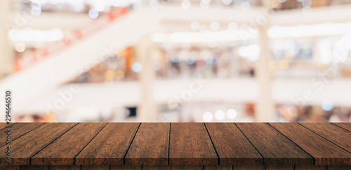 Fotografie, Obraz  Empty wood table and blurred light table in shopping mall with bokeh background