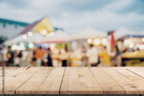 Fotografie, Obraz  Empty wood table and Vintage tone blurred defocused of crowd people in walking street festival and shopping mall