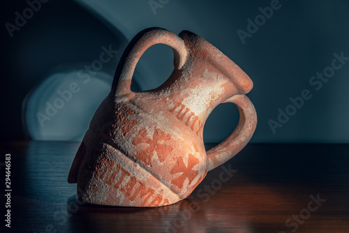 Broken old amphora on a wooden background Wallpaper Mural