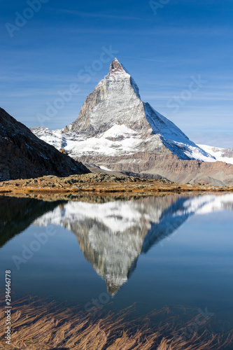 Reflection of Matterhorn peak over Riffelsee in Zermatt, Switzerland in autumn s Wallpaper Mural