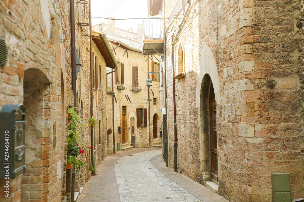 Fototapeta Cozy old Italian street in the heart of Italy.