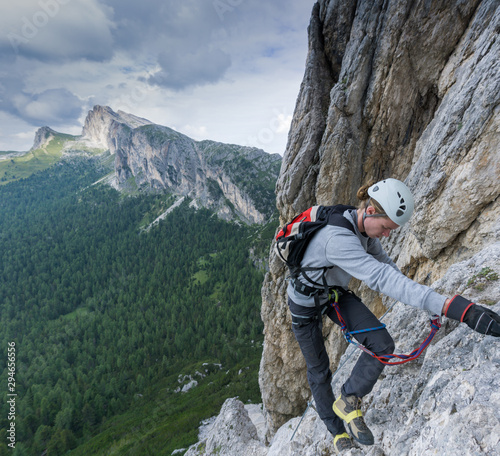 young male climber on a Via Ferrata in the Dolomites of Alta Badia with damaged Canvas Print