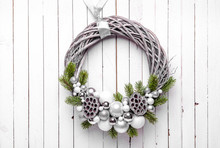 Christmas Wreath On Wood Background With Silver Ornaments And Christmas Tree Branches
