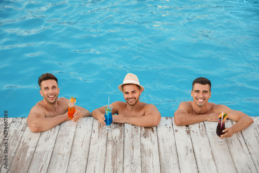 Fototapety, obrazy: Happy young friends with refreshing cocktails in swimming pool