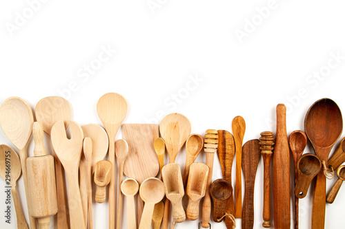 Valokuva  Collection of wooden kitchen utensils over white background