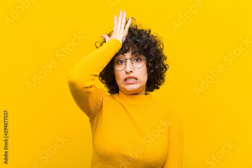 young pretty afro woman raising palm to forehead thinking oops, after making a s Fototapeta