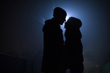 Silhouette Of A Couple In Love At Night On The Background Of The Moon