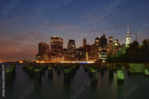 A view of the new york city skyline just after the sun has set. - 294682333