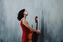 Young Woman With Cello Instrum...