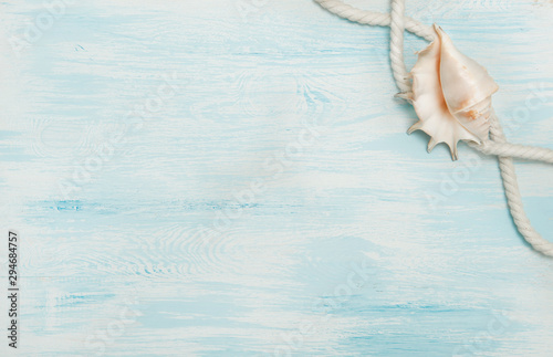 Fototapeta  Sea background with blue wood, rope, shells