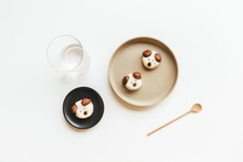 Cute Homemade Dog Shaped Cookies On Ceramic Plate With White Background
