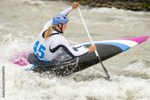 Cuadros en Lienzo Canoe slalom athlete racing on white water