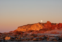 Full Moon Rising Over Red Cliffs