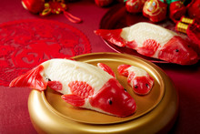 Chinese Traditional Food Koi Rice Cake ,on The Table In A Festive New Year Atmosphere