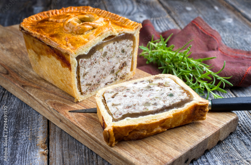 Fototapety, obrazy: Traditional French Pate en croute with chicken offered as closeup on a modern design cutting board