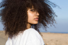Young Woman With Curly Hair In...