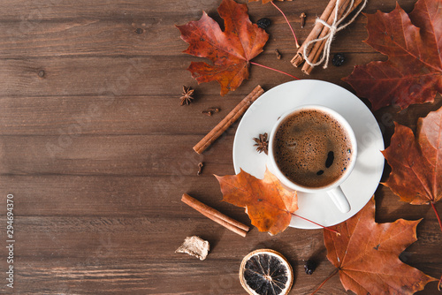 Cup of coffee with black coffee in a saucer on a wooden background, cinnamon, Wallpaper Mural