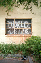 World Peace Spray Painted On W...