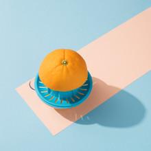 Orange On A Blue Squeezer