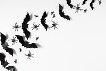 Halloween Decorations Concept. Halloween With Spiders, Black Bats On White Background. Flat Lay, Top View, Copy Space