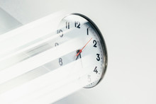 Analog Clock On White Wall