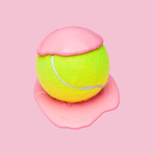Tennis Ball In Pink Puddle On Pink
