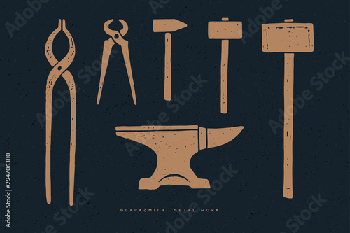 Fotografia Blacksmith tools on a dark background