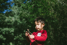 Little Kid Playing Outside