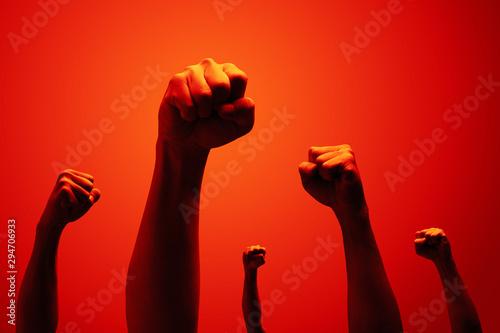 Fototapeta power fist raising in red