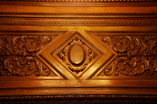 Part Of A Wood Carving Pattern. A Mahogany Pattern Adorns The Furniture.
