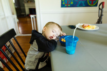 Toddler Boy Asleep In Chair At...