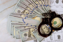 Police Handcuff In The Arrest Corruption And Money U.S. Dollars Banknotes And Criminal Investigation Fingerprint Record