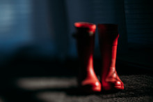 Blurry Photo Of Red Rain Boots...