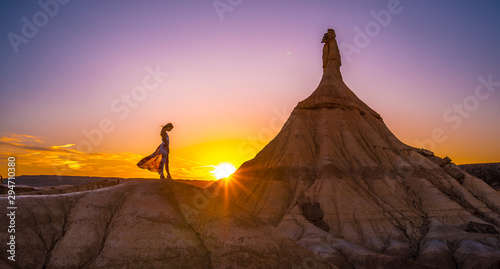 Lifestyle session of a girl with a dress at sunset in the Castildestones de las Bardenas. Navarre