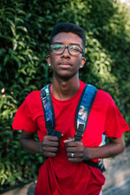 Young Student With Backpack And Glasses
