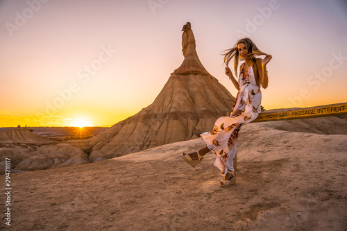 Canvas Prints Arizona Lifestyle session, A blonde girl sitting on bars with white dress in the Bardenas Reales. Navarre