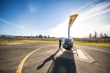 Pilot Prepares His Helicopter Prior To A Flight