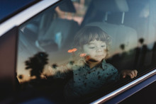 Toddler Boy In Driver's Seat O...