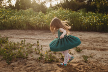 Little Girl Twirling Her Dress...