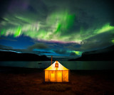 Aurora borealis over camp tent, Torngat Mountains national park