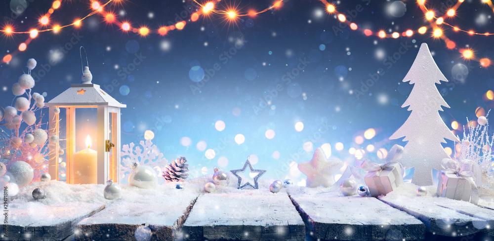 Fototapeta Christmas - Lantern And Gift On Snowy Table